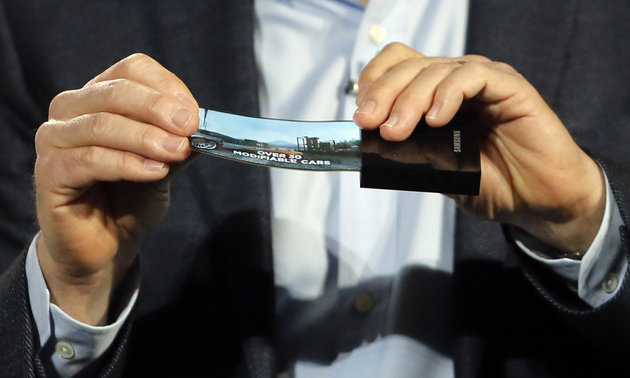 A prototype Windows smartphone with a flexible OLED display is seen during Samsung's keynote address at the International Consumer Electronics Show in Las Vegas, Wednesday, Jan. 9, 2013. (AP Photo/Jae C. Hong)
